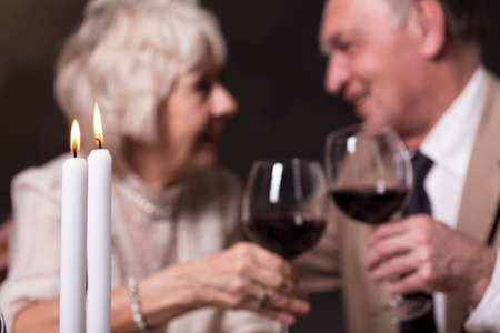 proposing a toast: Shot of an elderly couple having a romantic evening and proposing a toast Stock Photo