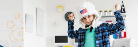 dress up: Little boy wearing space helmet for fun