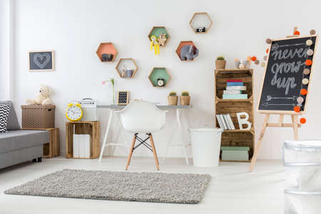 grey rug: Shot of a modern childrens room full of accessories
