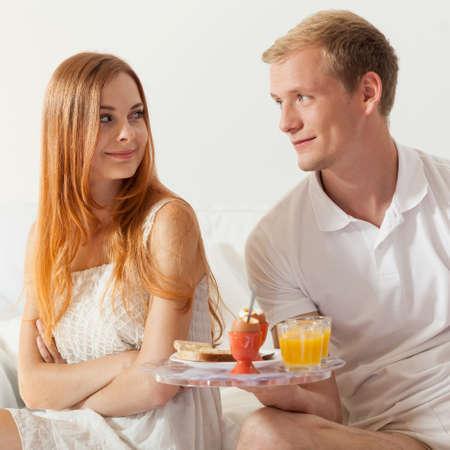 truelove: Men brings breakfast to his girlfriend Stock Photo