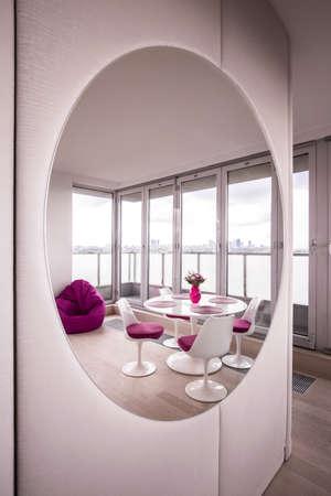 contemporary living room: Photo of contemporary light living room with big mirror
