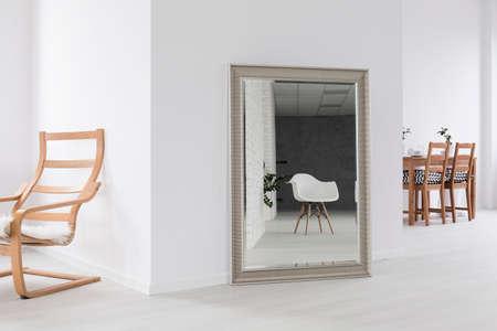 mirror frame: Big mirror in silver frame in white spacious interior