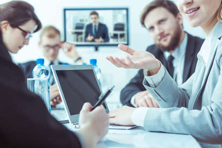 international business: Group of young businesspeople having international video conference in corporation Stock Photo