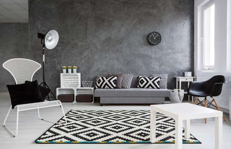 business lounge: Up-to-date elegant black and whitedecor of living room of businesspeople