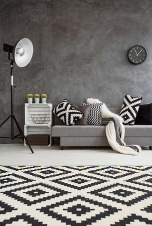 expensive house: Stylish design of new spacious interior of lounge in big expensive house. Black and white decorations in room