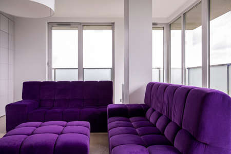 living room furniture: Image of modern living room with purple furniture Stock Photo