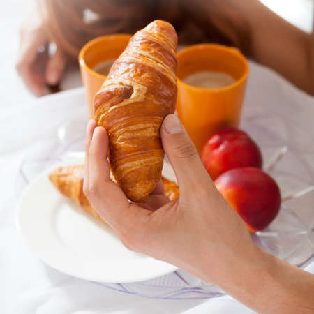 truelove: Eating breakfast in bed at hotel room Stock Photo