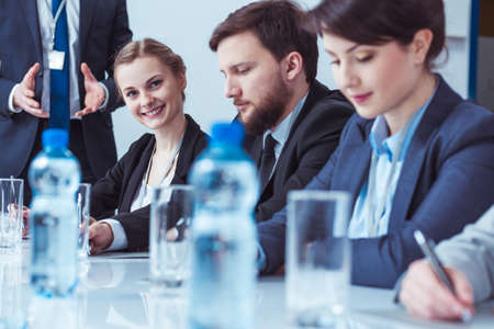 Corporations: Young elegant businesspeople working in big corporation. Management having a conference Stock Photo