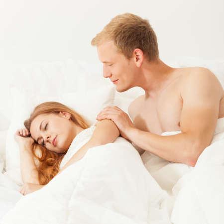 truelove: Men waking up his beautiful lover gently Stock Photo