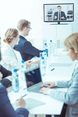 color consultation: Management of company during business consultation online with boss Stock Photo