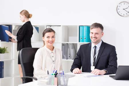 Happy businesspeople working in light, modern office