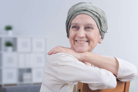 fighting cancer: Shot of a smiling woman after a chemotherapy