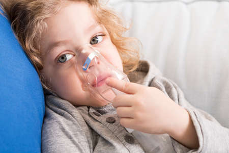 oxygen mask: Portrait of a sad little girl with oxygen mask