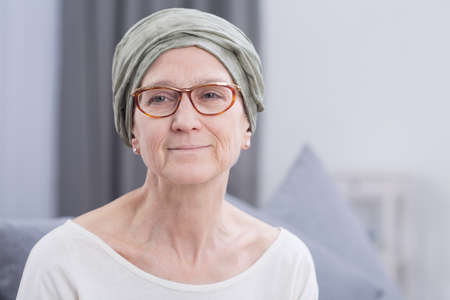 fighting cancer: Portrait of a sick woman wearing a headscarf