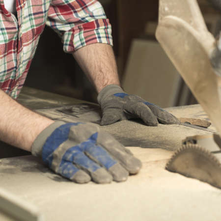 work gloves: Close up of carpenter with safety gloves during work