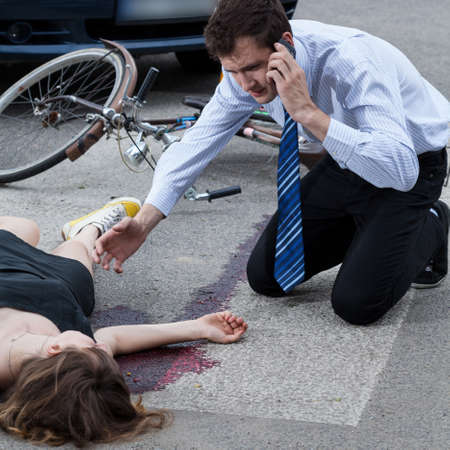Man calling the emergency service after car accident Stock Photo