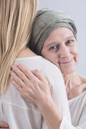 fighting cancer: Cropped picture of a sick mother hugging her daughter