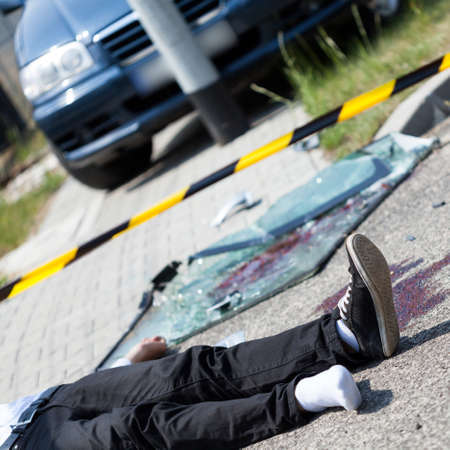 culprit: An injured man after a car accident lying in the street