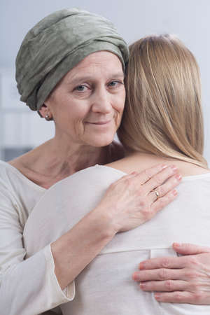 fighting cancer: Shot of a sick mother hugging her daughter
