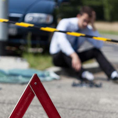 culprit: Closeup of area of a car accident and a man Stock Photo
