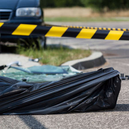 casualty: A casualty in a sack after a car accident