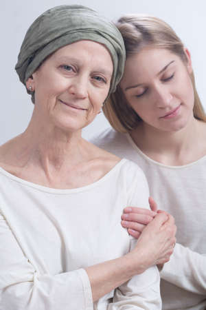 fighting cancer: Shot of a sick woman and her daugher Stock Photo