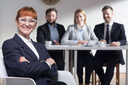 company job: Shot of a smiling businesswoman and her colleagues
