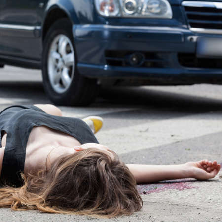 A dead woman in blood after a car accident Stock Photo