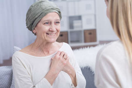 fighting cancer: Shot of a happy woman wearing a headscarf Stock Photo