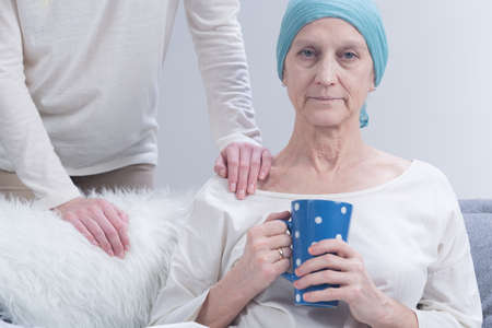 fighting cancer: Shot of a sick woman with a headscarf