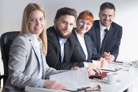 recruiters: Shot of four smiling recruiters at work Stock Photo