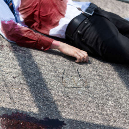 dissociation: Dead man after car accident on the street Stock Photo
