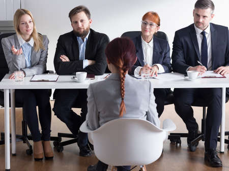 traineeship: Shot of businessmen interviewing a job applicant