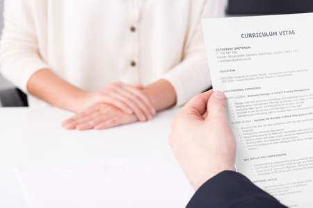 Corporations: Close up of a man holding womans cv