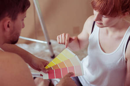 redecorate: Shot of a young couple choosing a colour for their walls Stock Photo