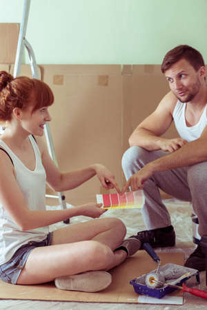redecorate: Shot of a young couple redecorating their flat