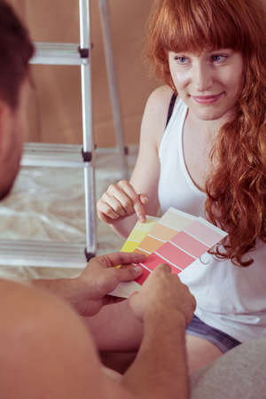 redecorate: Shot of a young couple choosing a colour from different colour swatches