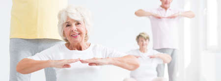 happy senior: Shot of a fitness class for seniors