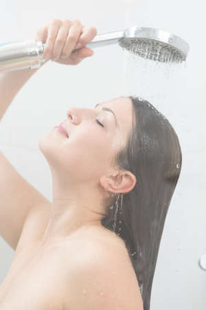 tiring: Woman taking relaxing shower after tiring long day Stock Photo