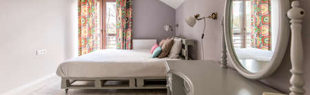 bedside lamps: Bright and calm bedroom with double bed and dressing table