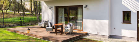 furniture part: Part of a house with terrace where are placed garden furniture Stock Photo