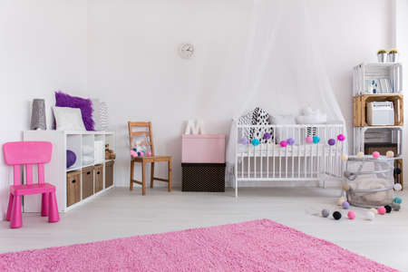 carpet: Cute pink and white bedroom designed for little baby girl. By the wall cradle and shelf. On the floor pink carpet