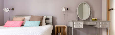 bedside: Bedroom with bed and bedside cabinet made from recycled materials Stock Photo