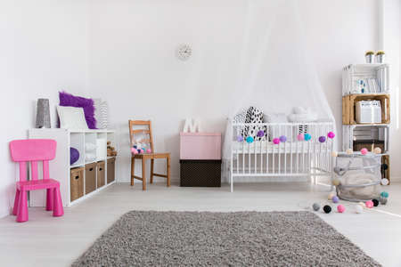 color design: Spacious modern babys room with soft grey carpet in the middle and white cradle by the wall