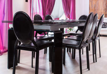 dining table and chairs: Photo of new design black dining table with chairs Stock Photo