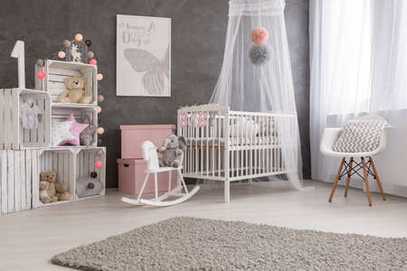 Shot of a cozy and modern baby girl room 스톡 콘텐츠