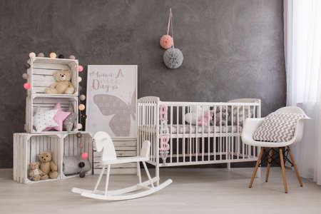 nursery room: Shot of a cozy baby girl nursery room Stock Photo