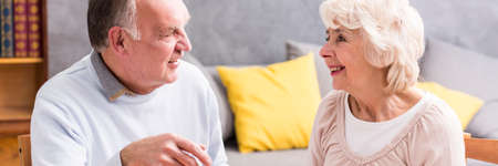 nice living: Senior man and woman in nice discussion in living room