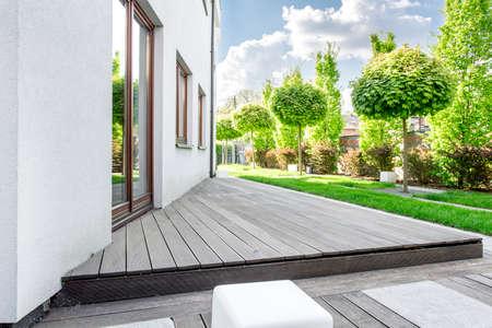 White modern villa with patio and garden Foto de archivo