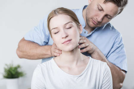 Woman at physiotherapists having her cervical spine massage 版權商用圖片